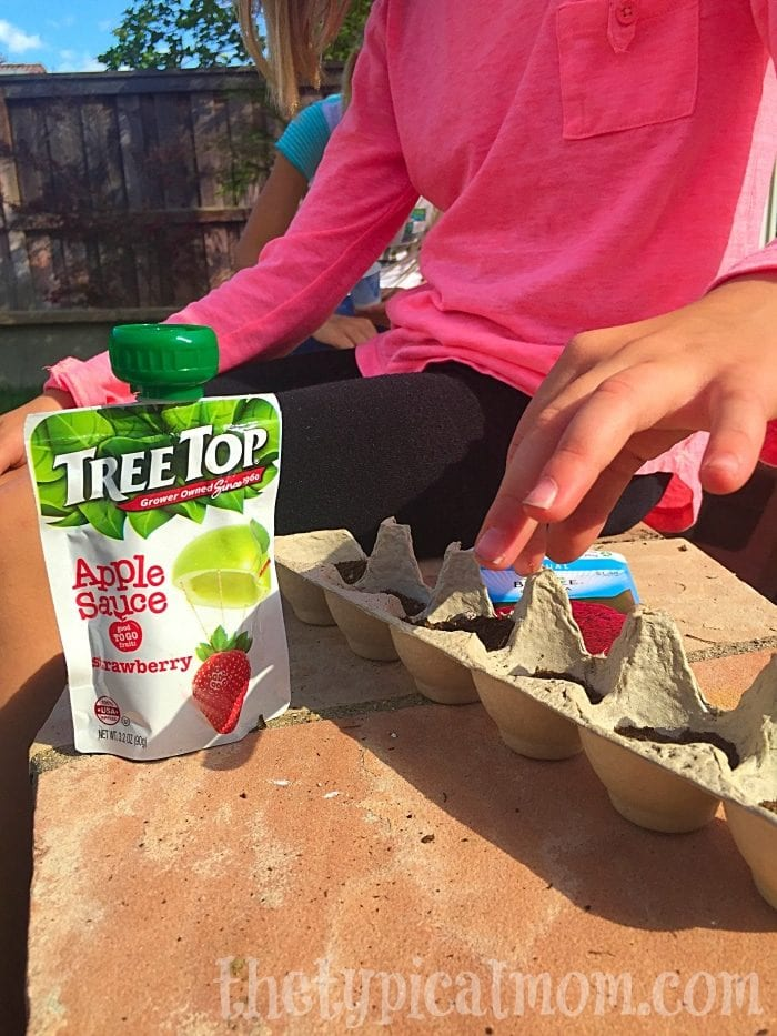 Tree Top applesauce squeeze pouches are the perfect snack when gardening with kids.
