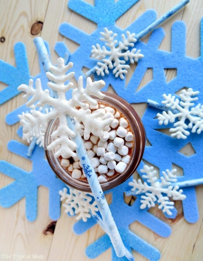 Chocolate snowflake stirrers perfect for a FROZEN birthday party or hot chocolate stirrers for Christmas. These are so fun to make!